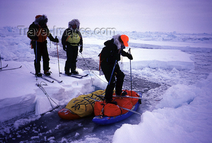 north-pole1: Arctic Ocean: crossing a narrow lead - improvised bridge (photo by Eric Philips) - (c) Travel-Images.com - Stock Photography agency - Image Bank