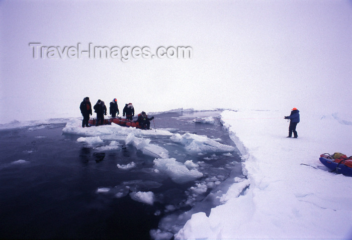 north-pole10: Arctic Ocean: using a block of ice as a raft to cross a lead of open water - North Pole expedition (photo by Eric Philips) - (c) Travel-Images.com - Stock Photography agency - Image Bank