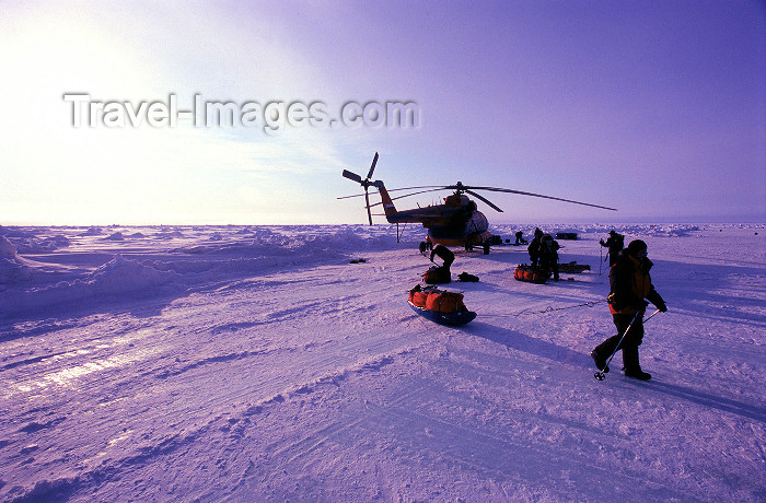 north-pole5: Arctic Ocean: Russian MI-8 helicopter and skiers - North Pole expedition (photo by Eric Philips) - (c) Travel-Images.com - Stock Photography agency - Image Bank