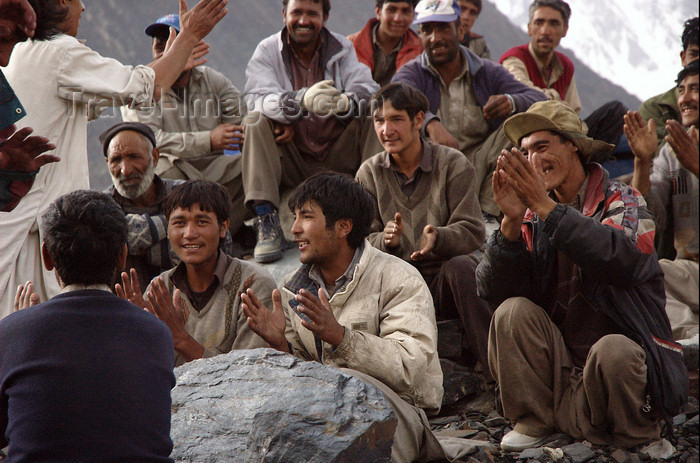 pakistan120: Pakistan - Karakoram mountains - Himalayan range - Northern Areas: Balti porters sing and relax - photo by A.Summers - (c) Travel-Images.com - Stock Photography agency - Image Bank