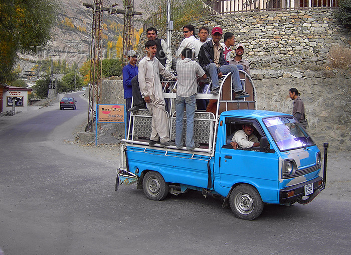 pakistan165: Karimabad / Baltit - Northern Areas, Pakistan: riding is better than walking - crowded Chinese made pick-up truck - Hunza Valley - KKH - photo by D.Steppuhn - (c) Travel-Images.com - Stock Photography agency - Image Bank