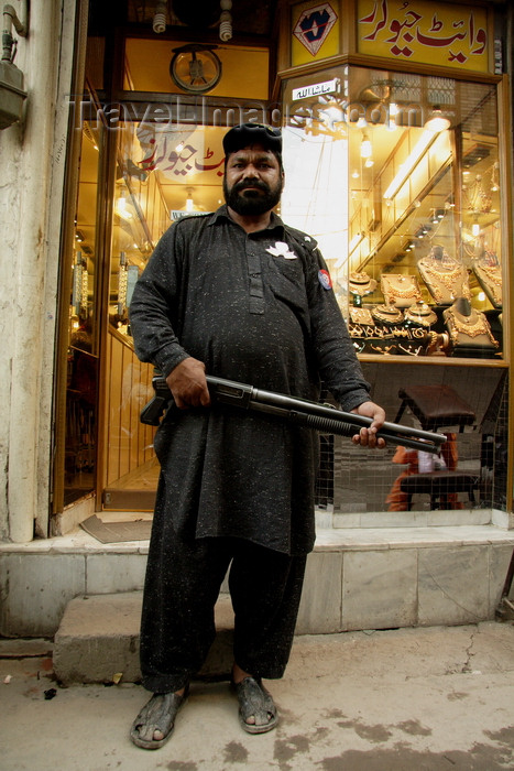 pakistan195: Lahore, Punjab, Pakistan: security guard armed with a shotgun in front of a jeweler - gold  - photo by G.Koelman - (c) Travel-Images.com - Stock Photography agency - Image Bank