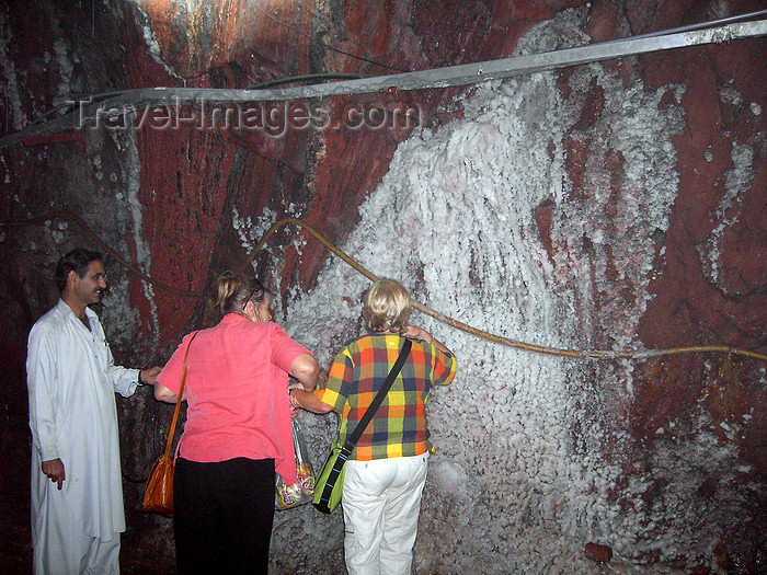 pakistan20: Jhelum District, Punjab, Pakistan: Khewra Salt Mines - tourists and wall of almost pure Sodium chloride - photo by D.Steppuhn - (c) Travel-Images.com - Stock Photography agency - Image Bank