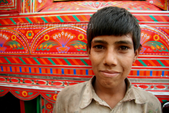 pakistan207: Peshawar, NWFP, Pakistan: portrait of a boy in front of a decorated truck - photo by G.Koelman - (c) Travel-Images.com - Stock Photography agency - Image Bank