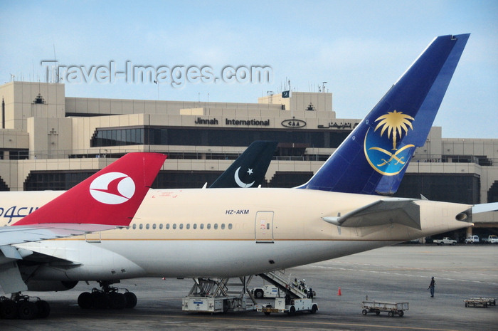 pakistan37: Karachi, Sindh, Pakistan: Jinnah International Airport - KHI - Karachi Airport, former Quaid-e-Azam airport - ICN - crecents and airliners - Turkish Airlines, Pakistan International Airlines, Saudi Arabian Airlines - Boeing 777-268 (ER) HZ-AKM cn 28356 - photo by M.Torres - (c) Travel-Images.com - Stock Photography agency - Image Bank