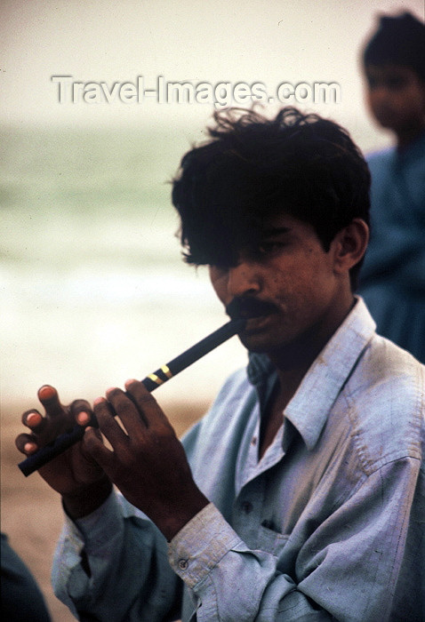 pakistan60: Karachi, Sindh, Pakistan: musical evening - man playing the flute on the beach - photo by R.Zafar - (c) Travel-Images.com - Stock Photography agency - Image Bank
