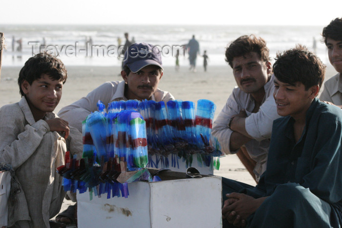 pakistan74: Karachi, Sindh, Pakistan: man selling toy airplanes on the beach - photo by R.Zafar - (c) Travel-Images.com - Stock Photography agency - Image Bank