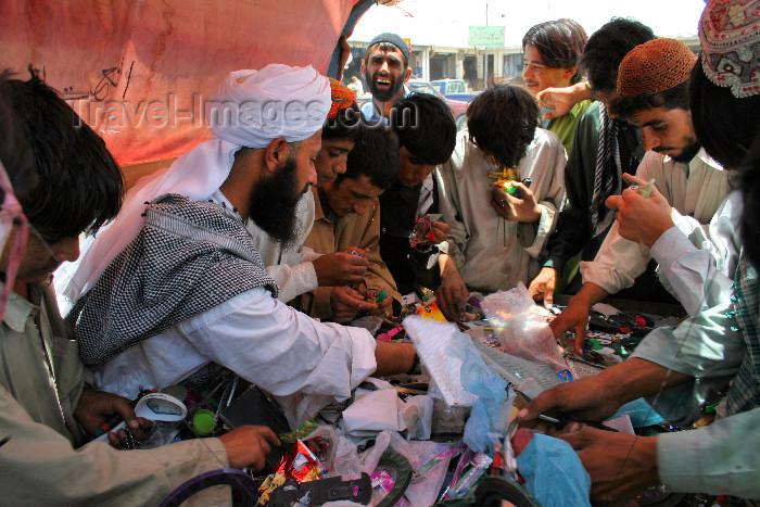 pakistan8: Taftan, Balochistan, Pakistan: men inspect goods in the bazaar - photo by A.Slobodianik - (c) Travel-Images.com - Stock Photography agency - Image Bank