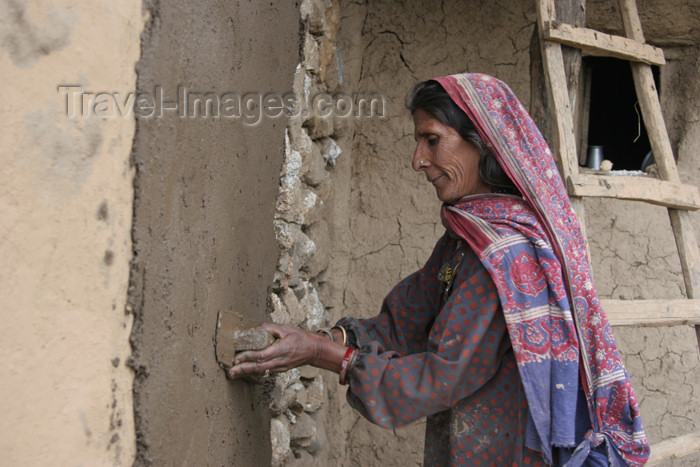 pakistan97: Kodar Bala, Siran Valley, North-West Frontier Province, Pakistan: old woman plastering a house - photo by R.Zafar - (c) Travel-Images.com - Stock Photography agency - Image Bank