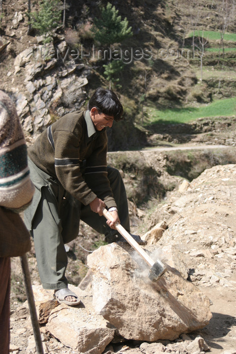 pakistan98: Kodar Bala, Siran Valley, North-West Frontier Province / NWFP, Pakistan: young man breaking stones for construction - photo by R.Zafar - (c) Travel-Images.com - Stock Photography agency - Image Bank