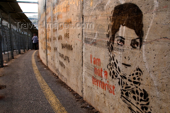 palest15: Bethlehem, West Bank, Palestine: graffitti on wall outside checkpoint - Palestinian woman's face and caption 'I am not a terrorist' - photo by J.Pemberton - (c) Travel-Images.com - Stock Photography agency - Image Bank