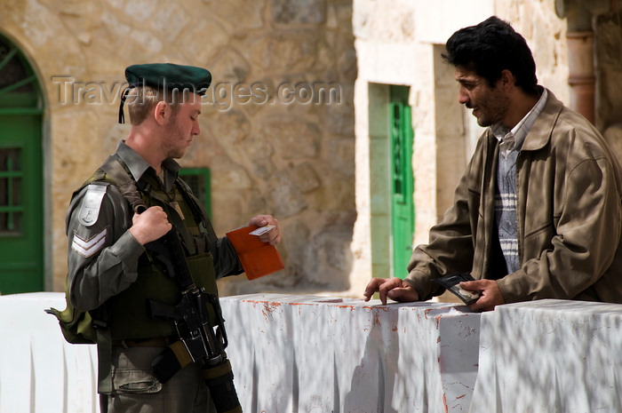 palest25: Hebron, West Bank, Palestine: Israeli soldier checking Palestinian ID at checkpoint - photo by J.Pemberton - (c) Travel-Images.com - Stock Photography agency - Image Bank