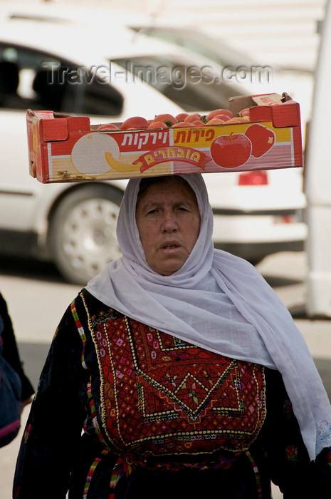 palest29: Hebron, West Bank, Palestine: Palestinian woman in traditional dress transporting a box of Israeli tomatoes - photo by J.Pemberton - (c) Travel-Images.com - Stock Photography agency - Image Bank