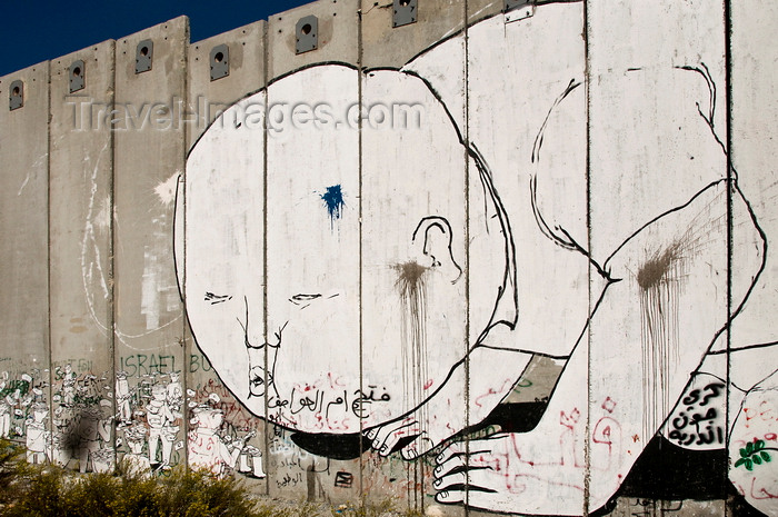 palest35: near Bethlehem, West Bank, Palestine: graffitti on Wall - blowing - concrete slabs of the separation fence - photo by J.Pemberton - (c) Travel-Images.com - Stock Photography agency - Image Bank