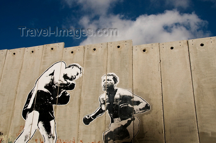 palest36: near Bethlehem, West Bank, Palestine: graffitti on Wall - boxers - concrete slabs of the separation fence - photo by J.Pemberton - (c) Travel-Images.com - Stock Photography agency - Image Bank