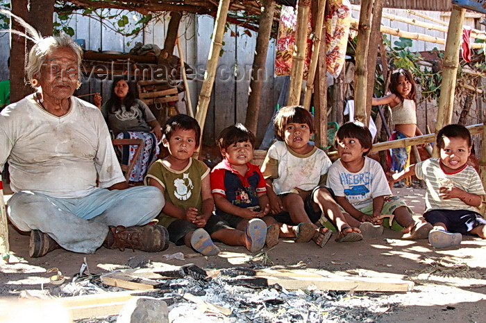 paraguay80: Presidente Hayes department, Paraguay: Maka indians near Puente Remanso - elderly man with the village's children - photo by A.Chang - (c) Travel-Images.com - Stock Photography agency - Image Bank
