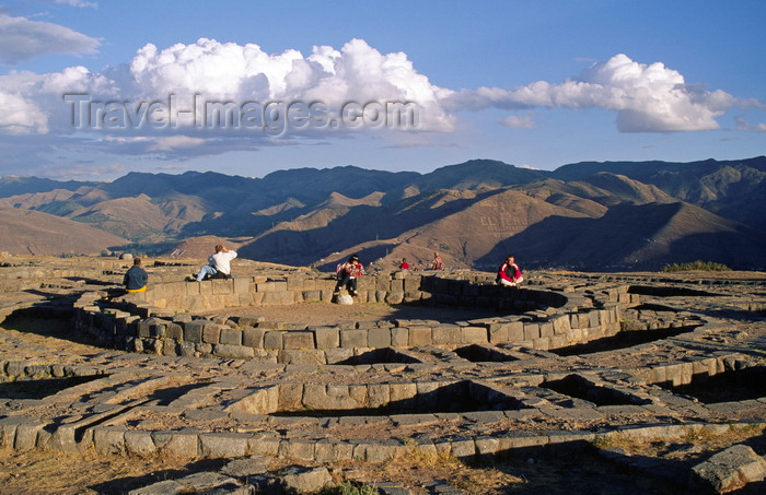 peru133: Cuzco, Peru: people sit on the foundation of Muyucmarca, one of  Sacsayhuaman's three great towers - view of the mountains - photo by C.Lovell - (c) Travel-Images.com - Stock Photography agency - Image Bank