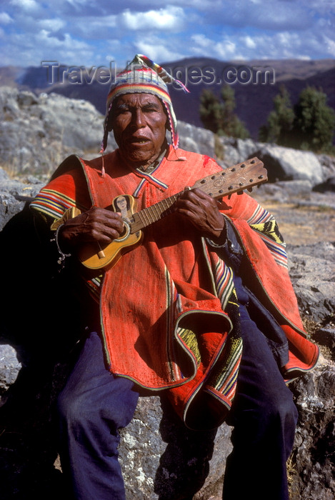 peru136: Cuzco region, Peru: old Quechua man playing guitar - Peruvian Andes - photo by C.Lovell - (c) Travel-Images.com - Stock Photography agency - Image Bank