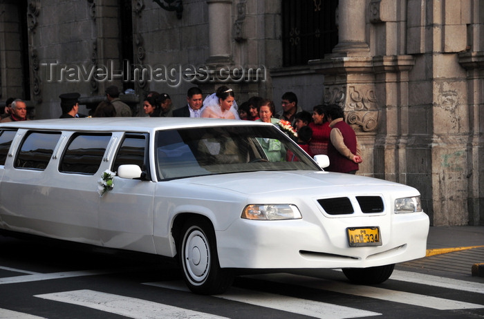 peru72: Lima, Peru: GAZ Volga limo brings a bride to her wedding - Archbishop's palace in the background - photo by M.Torres - (c) Travel-Images.com - Stock Photography agency - Image Bank