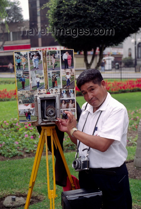 peru76: Miraflores, Lima, Peru: photographer with old time camera with photos in the main - photo by C.Lovell - (c) Travel-Images.com - Stock Photography agency - Image Bank