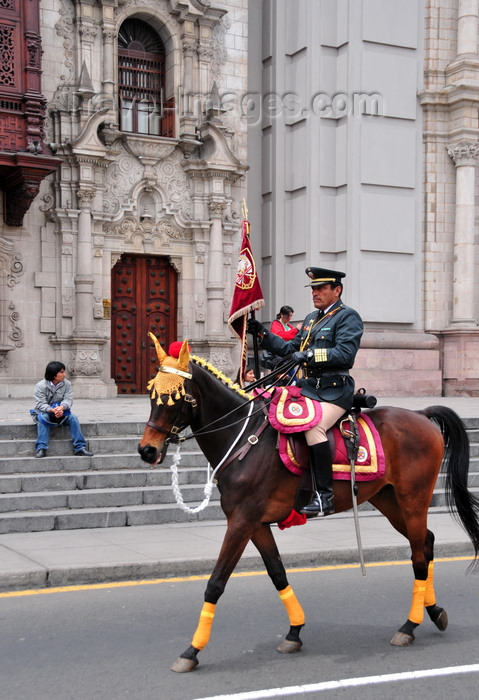 peru82: Lima, Peru: mounted officer leads the change of the guard cort&#232;ge - Plaza de Armas, in front of the Archbishop's palace - photo by M.Torres - (c) Travel-Images.com - Stock Photography agency - Image Bank