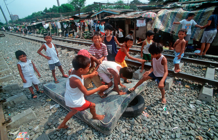 phil20: Manila city, Philippines - children play with an old matress - Slums and shanty towns - photo by B.Henry - (c) Travel-Images.com - Stock Photography agency - Image Bank