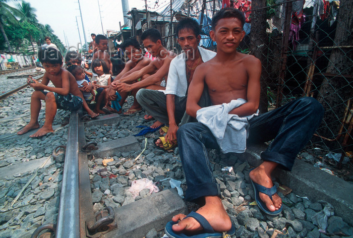 phil21: Manila city, Philippines - youths on the railway tracks - Slums and shanty towns - photo by B.Henry - (c) Travel-Images.com - Stock Photography agency - Image Bank
