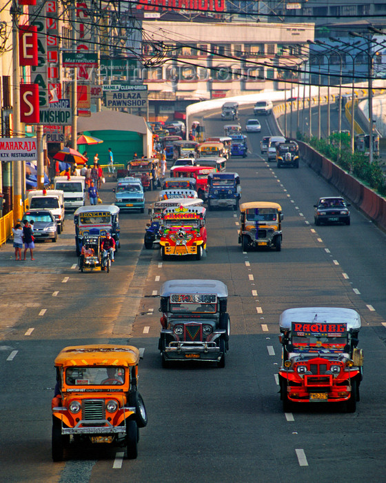 phil41: Manila city, Philippines - Jeepney busses -  photo by B.Henry - (c) Travel-Images.com - Stock Photography agency - Image Bank