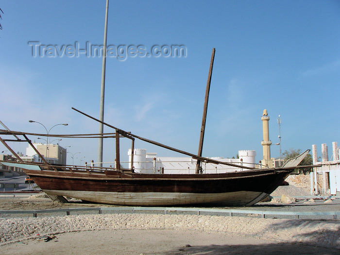 qatar13: Doha, Qatar: fishing dhow on land  - Al-Khoot Fort in the background - Dhow Round About - photo by B.Cloutier - (c) Travel-Images.com - Stock Photography agency - Image Bank