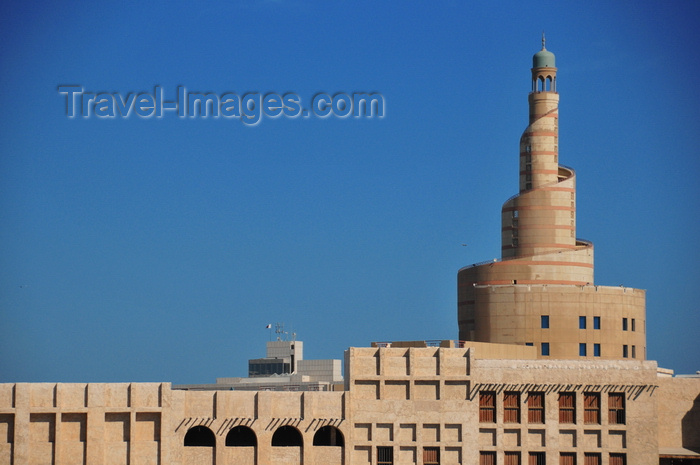 qatar24: Doha, Qatar: the spiral minaret of Qatar Islamic Cultural Center (FANAR) towers above the old buildings of Souq Waqif - photo by M.Torres - (c) Travel-Images.com - Stock Photography agency - Image Bank