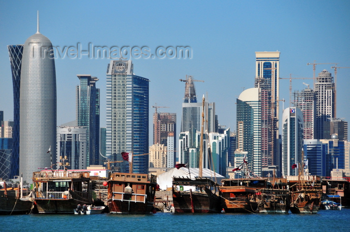 qatar33: Doha, Qatar: West Bay skyline and sterns of dhows in the dhow harbour - Burj Qatar - dhows and skyscrapers - photo by M.Torres - (c) Travel-Images.com - Stock Photography agency - Image Bank
