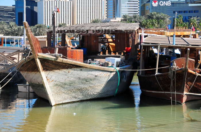 qatar39: Doha, Qatar: prow view of dhows in the Dhow harbour - Corniche in the background - Qatar National Bank building - photo by M.Torres - (c) Travel-Images.com - Stock Photography agency - Image Bank