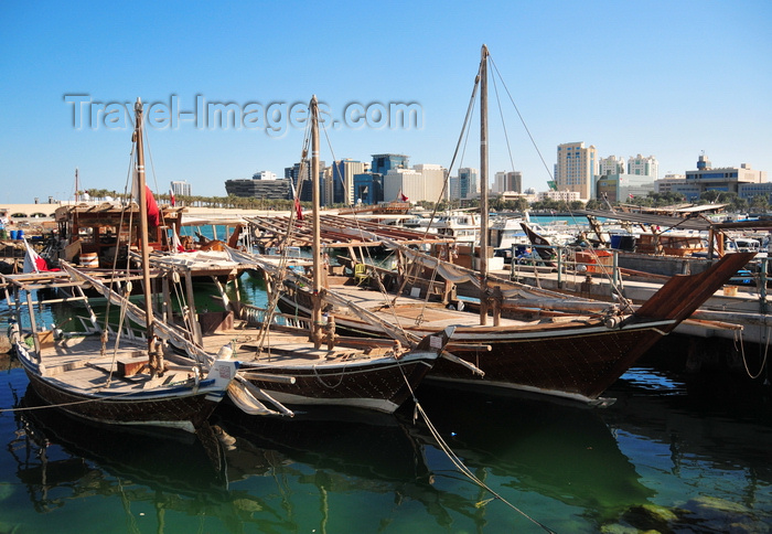 qatar46: Doha, Qatar: three dhows in the Dhow harbour - south end of the Corniche in the background, from the Ministry of Finance to the Al Hitmi Towers - photo by M.Torres - (c) Travel-Images.com - Stock Photography agency - Image Bank