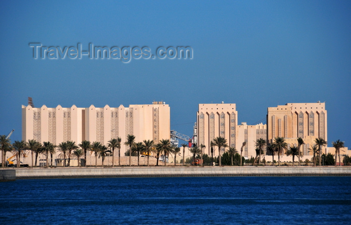 qatar51: Doha, Qatar: harbour cereal silos with local architecture inspiration - Qatar Flour Mills Co.- photo by M.Torres - (c) Travel-Images.com - Stock Photography agency - Image Bank