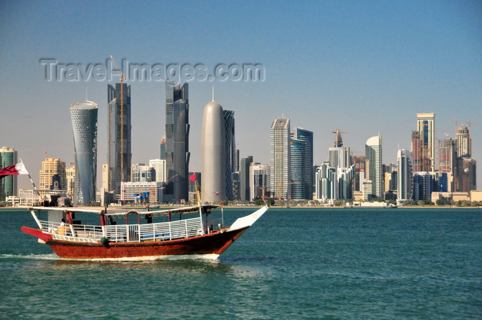 qatar55: Doha / Ad Dawhah, Qatar: water taxi dhow on Doha bay and West Bay skyline from the south side of Doha Bay - photo by M.Torres - (c) Travel-Images.com - Stock Photography agency - Image Bank