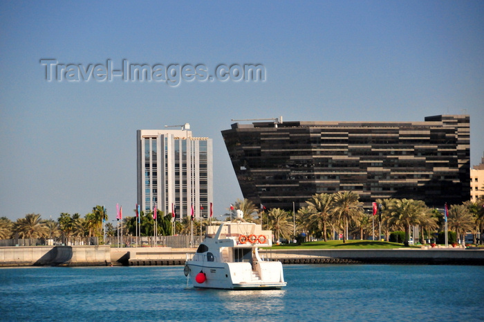 qatar57: Doha, Qatar: Al Hitmi Towers (right) designed by Norr-Group Architects and Sultan Bin Abdullah Al-Asiri tower, housing the Qatar Port Management Company - yacht in front of the Corniche - photo by M.Torres - (c) Travel-Images.com - Stock Photography agency - Image Bank