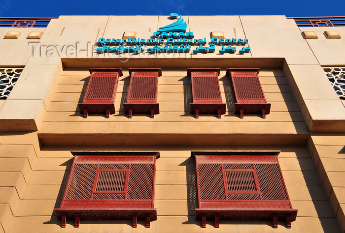 qatar84: Doha, Qatar: Qatar Islamic Cultural Center, FANAR - stone facade with arabian enclosed oriel windows with carved wood - Mashrabiya or Shanasheel - photo by M.Torres - (c) Travel-Images.com - Stock Photography agency - Image Bank