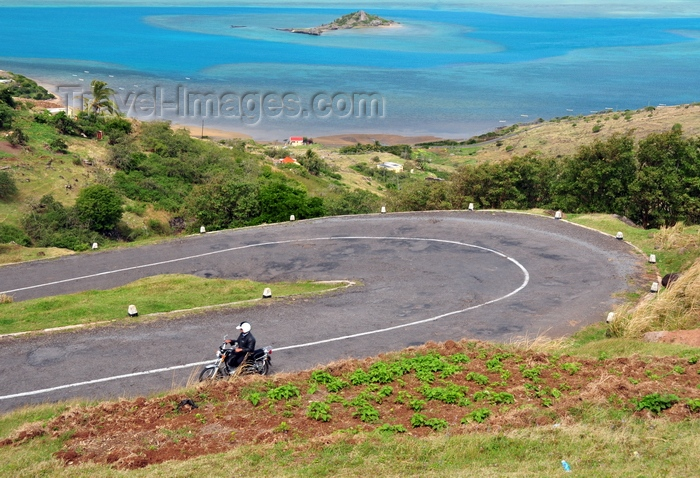rodrigues31: Pompée, Rodrigues island, Mauritius: motorbike climbing the winding road - lagoon and Hermitage island in the background - photo by M.Torres - (c) Travel-Images.com - Stock Photography agency - Image Bank