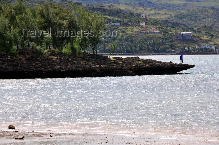 rodrigues4: Anse Grand Var, Rodrigues island, Mauritius: man at the end of an eroded and windswept rock promontory - photo by M.Torres - (c) Travel-Images.com - Stock Photography agency - Image Bank