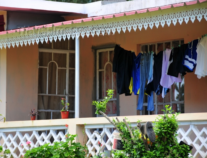 rodrigues73: La Ferme, Rodrigues island, Mauritius: creole house with ornate eaves and clothes line - photo by M.Torres - (c) Travel-Images.com - Stock Photography agency - Image Bank