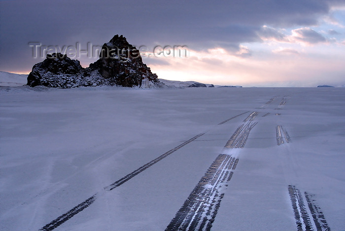 russia24: Lake Baikal, Irkutsk oblast, Siberian Federal District, Russia: tire tracks along Olkhon island - ice and snow - photo by B.Cain - (c) Travel-Images.com - Stock Photography agency - Image Bank