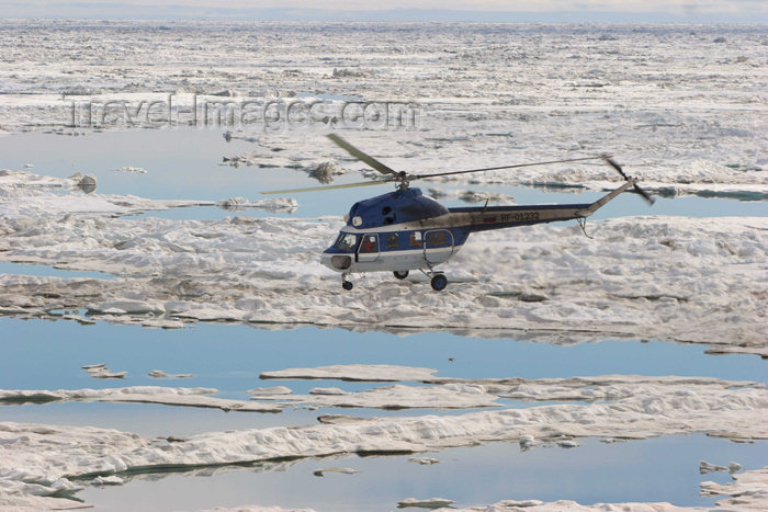 russia426: Russia - Bering Strait (Chukotka AOk): MI-2 helicopter ferries passengers over the ice (photo by R.Eime) - (c) Travel-Images.com - Stock Photography agency - Image Bank