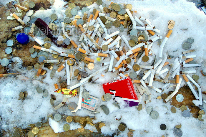 russia761: Lake Baikal, Irkutsk oblast, Siberian Federal District, Russia: Shaman oifferings - money and cigarettes on the snow - photo by B.Cain - (c) Travel-Images.com - Stock Photography agency - Image Bank