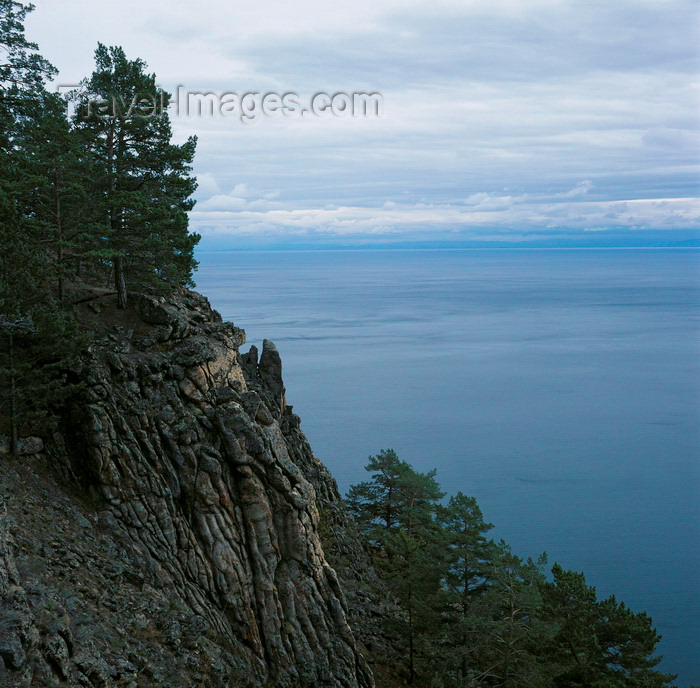 russia766: Lake Baikal, Irkutsk oblast, Siberia, Russia: pine trees and basalt rocks on the eastern shore of Olchon Island in Lake Baikal - natural sculpted cliffs - photo by A.Harries - (c) Travel-Images.com - Stock Photography agency - Image Bank