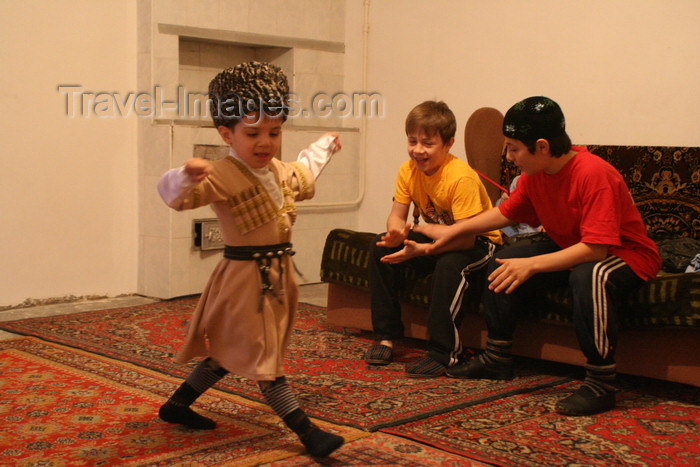 russia773: Chechnya, Russia - a boy wearing Chechen national costume and dancing traditional Chechen dance - photo by A.Bley - (c) Travel-Images.com - Stock Photography agency - Image Bank
