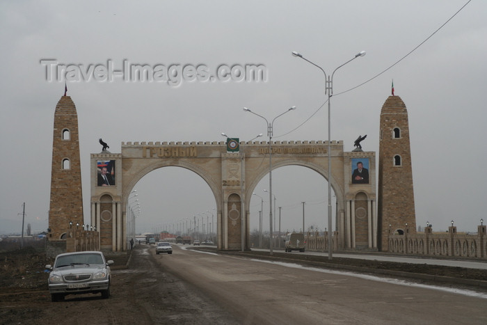 russia794: Chechnya, Russia - Grozny - city gates with posters of Putin and Kadirov Sr - GAZ Volga automobile on the left - photo by A.Bley - (c) Travel-Images.com - Stock Photography agency - Image Bank