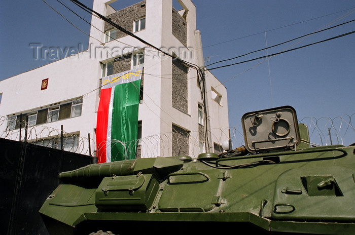 russia795: Chechnya, Russia - building, APC, barbed wire, flag of Chechnya and Russian coat of arms - photo by A.Bley - (c) Travel-Images.com - Stock Photography agency - Image Bank