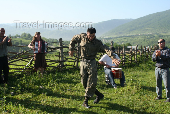 russia800: Chechnya, Russia - man in uniform dances traditional Chechen dance in meadow - photo by A.Bley - (c) Travel-Images.com - Stock Photography agency - Image Bank
