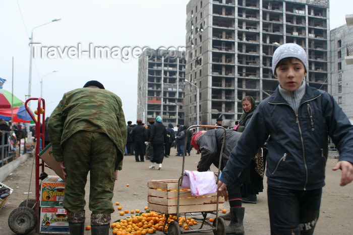 russia802: Chechnya, Russia - Grozny - market in front of destroyed buildings - tangerine stall - photo by A.Bley - (c) Travel-Images.com - Stock Photography agency - Image Bank