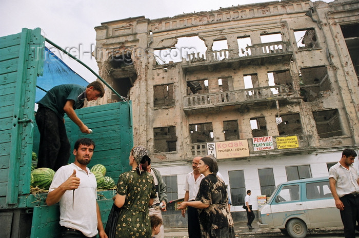 russia804: Chechnya, Russia - Grozny - men selling the watermelons from the back of a truck in front of a ruined building - photo by A.Bley - (c) Travel-Images.com - Stock Photography agency - Image Bank